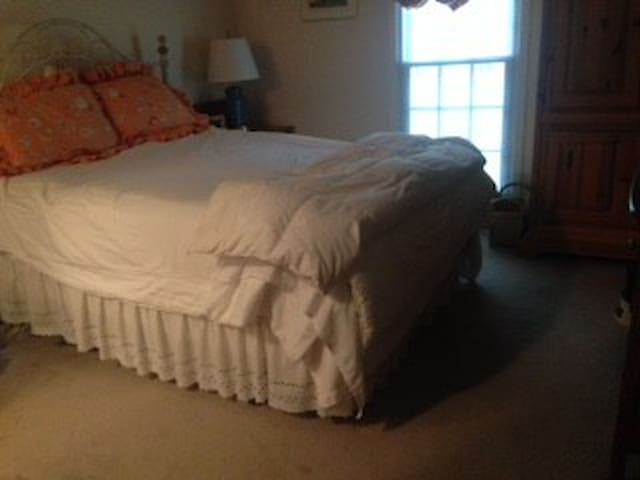 Queen size master bed with attached bath and half bath downstairs.