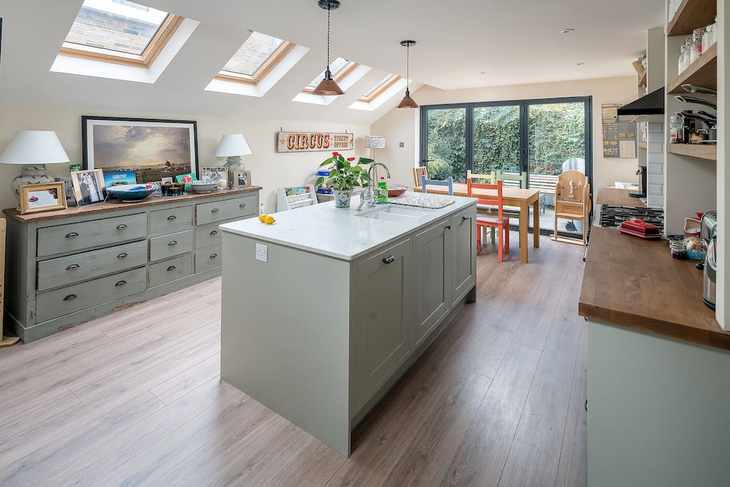 Kitchen with dining area opening out onto the garden - a rarity in London!