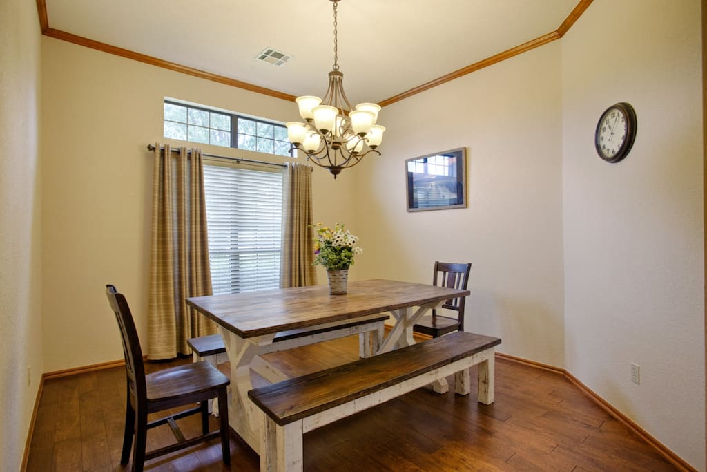 Formal dining with a beautiful handmade farmhouse table that comfortably seats 8 people.