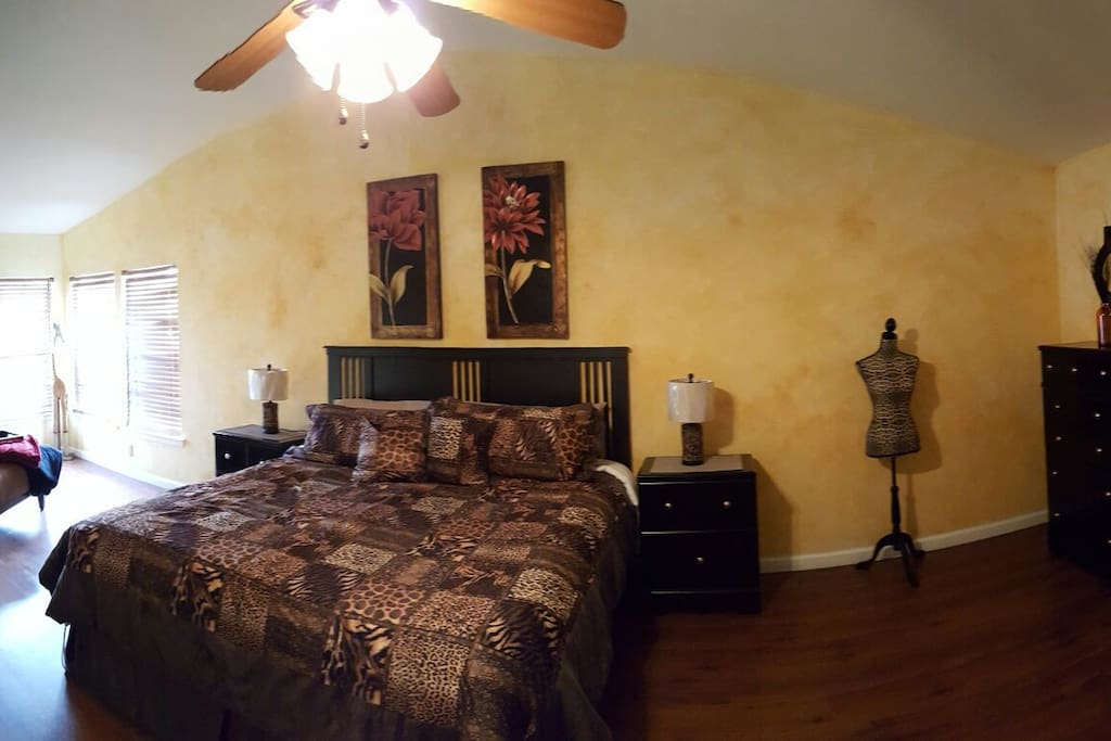 Master bedroom with king bed and sitting area.