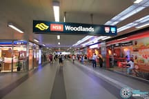 Woodlands MRT Station (5 minutes walk / 2 bus stops away from the apartment). Lots of eateries, bakeries, shops and ATMs at the station. It's also right in front of Causeway Point shopping mall.