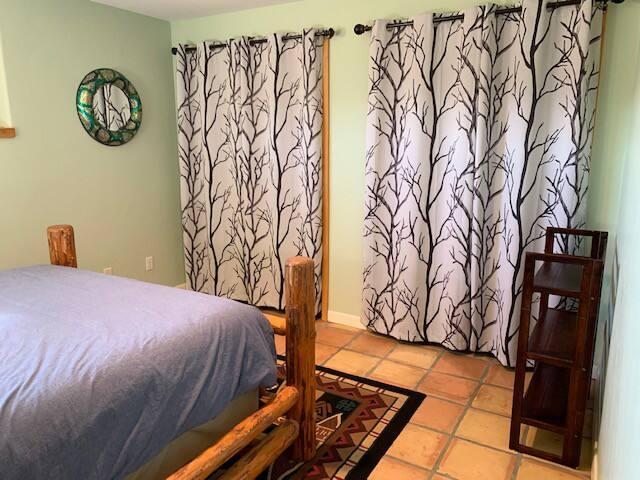 Bedroom w/ queen bed.  In closet: games, puzzles, fan, humidifier, hamper & dresser.