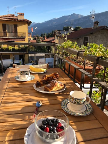 Breakfast on the balcony. Great views of local life and the mountains.