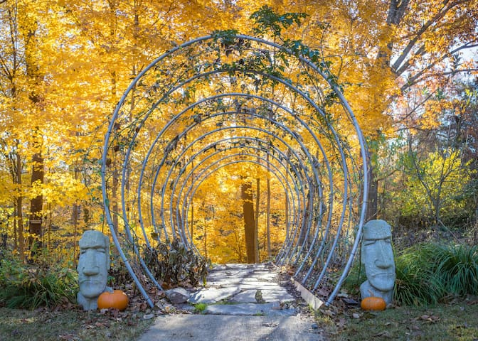 "This tunnel marks the main entrance from the treehouse to Richmond's trail system--one of the most celebrated trail systems on the East Coast. You have private access to the trail from two locations on the treehouse property. These two heads guarding the tunnel are our ""trail heads."" Roses grow over the tunnel in the summer months and lights adorn the tunnel year-round."
