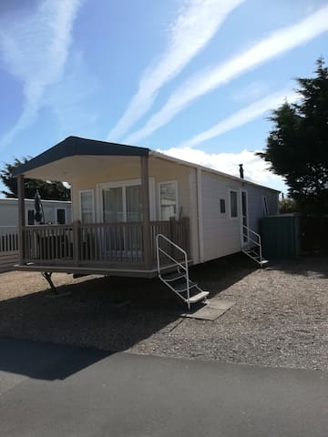 Seaside caravan with a veranda
