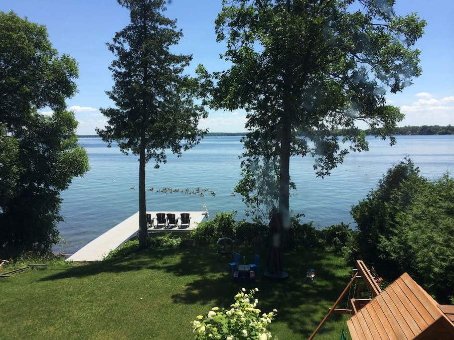 There is a fully renovated walk-out basement with direct access to the lake.   It has a large dock for entertaining, lounging and swimming.  Shallow water entry for children. Although there is a a lake that has a sandy bottom, it is highly advised to wear water shoes due to sharp rocks and mussels near the shoreline.  Warning: No diving off the dock.