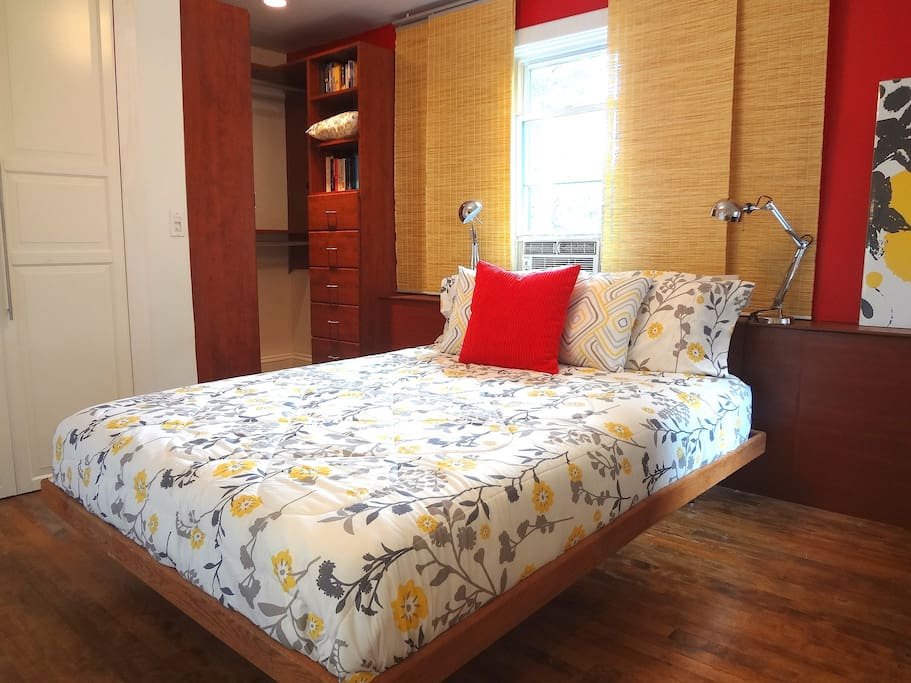 Queen size bedroom with California Closets.