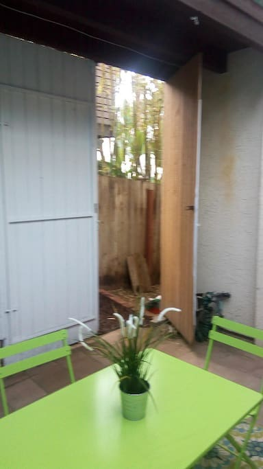 Entrance from side of home into patio and suite