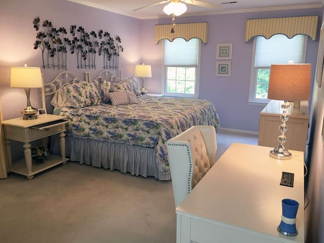 """Second floor: """"Once in a Blue Room"""" king bed (view to front yard); recently refreshed with new furniture, lamps and wall decor."""