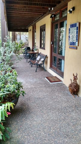 Guest verandah with plenty of seating and a small BBQ
