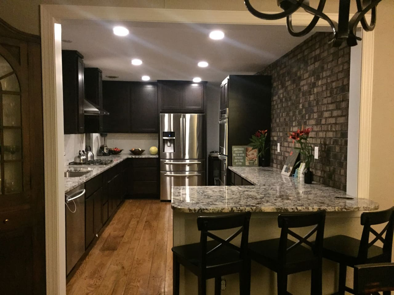 Main level kitchen. 5 burner cooktop and double ovens. Breakfast bar seating.