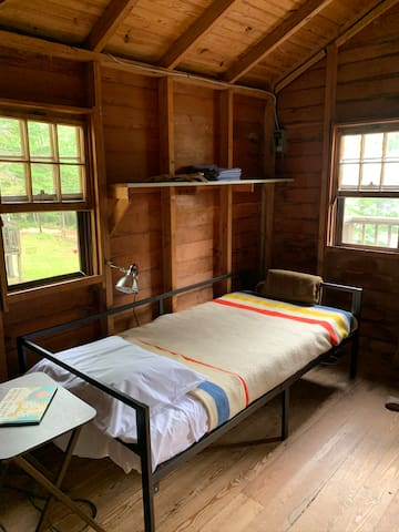 Cabin 1 daybed. New and select vintage wool blankets on all beds.