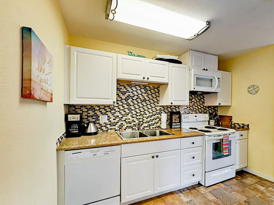 Prepare meals with ease in the roomy, well-equipped kitchen.