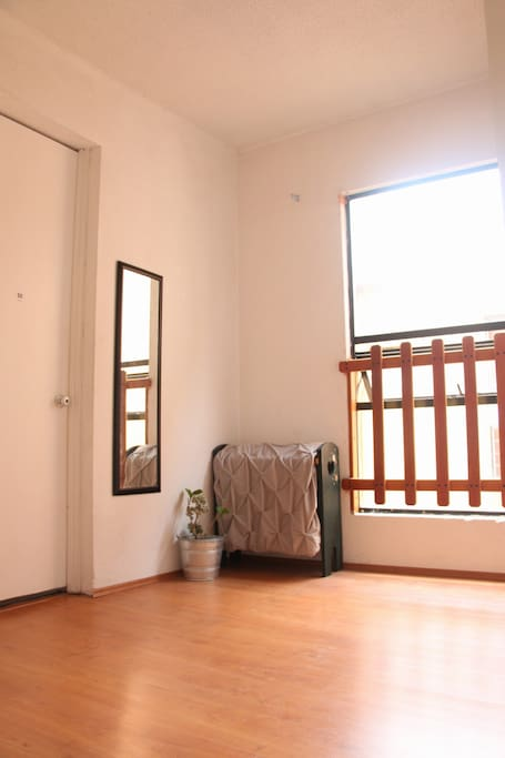 Super luminous room and so spacious! Extra mattress can be placed in the floor if needed.