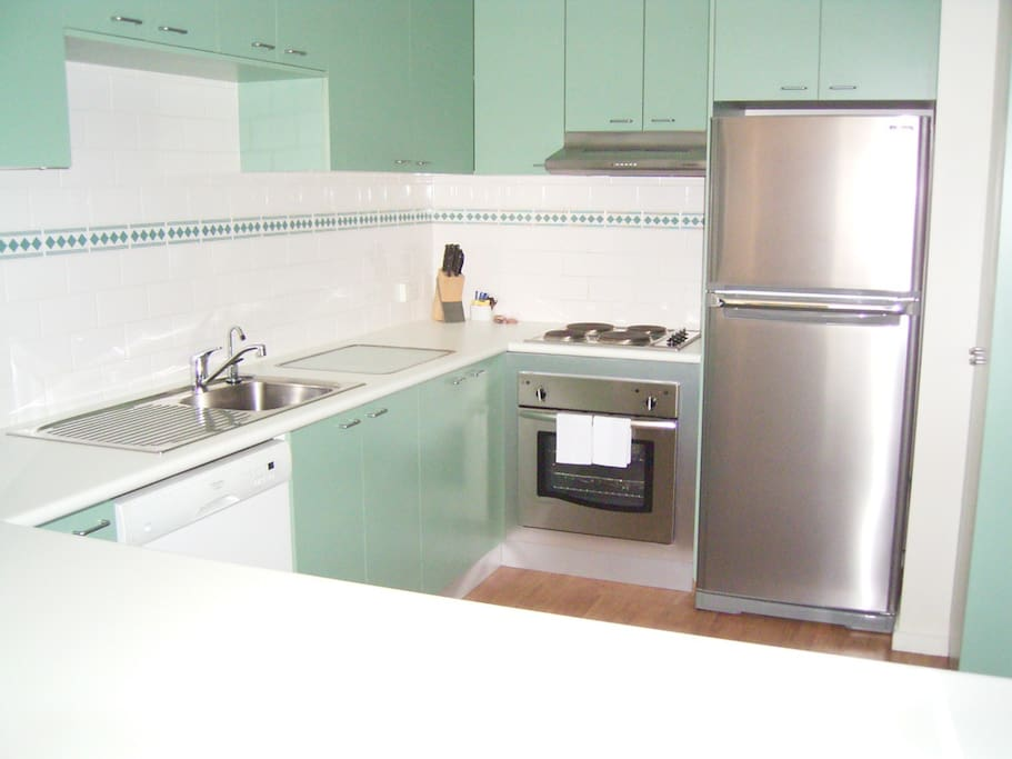 Fully equiped kitchen and laundry in each apartment