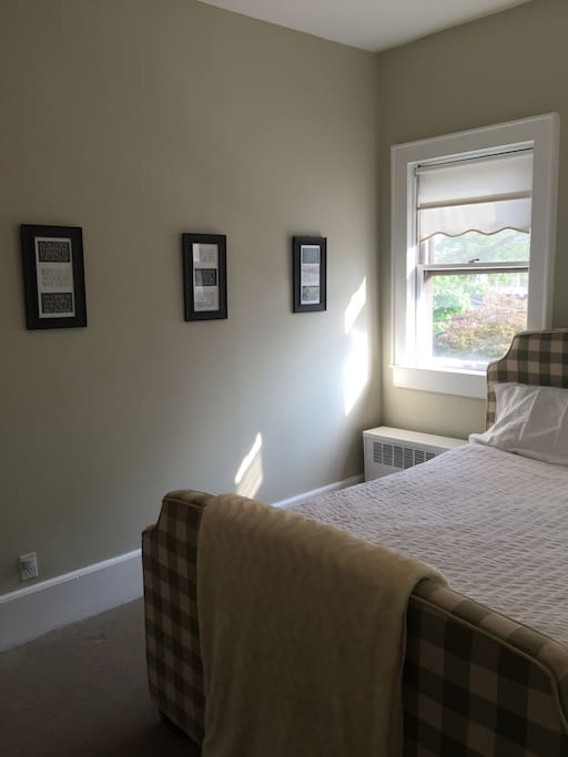 Beautifully decorated room with privacy blinds