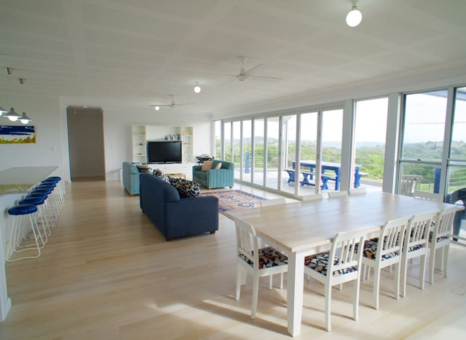 Open plan kitchen, dining and living area with a nice sea view.