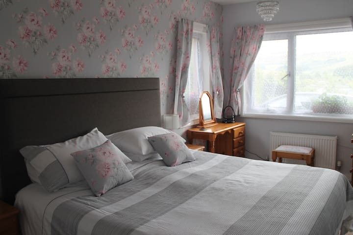 Super kingsize bed with view of the fells