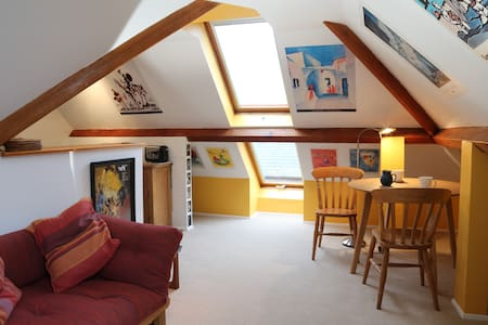 Cosy attic flat in a converted pub.