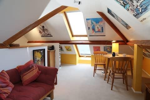 Cosy attic flat in a converted pub.