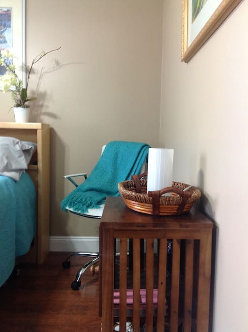 Room has side chair, dresser, all the comforts of home.