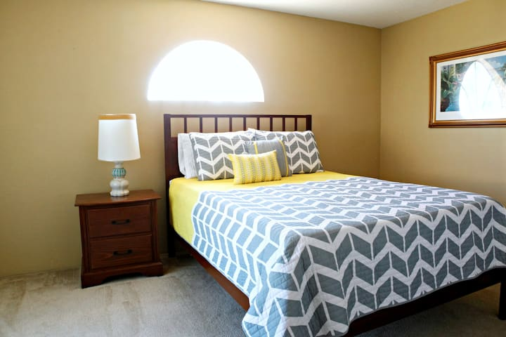 guest bedroom with large closet and queen bed