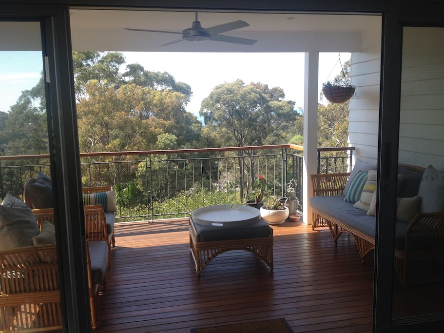 Covered front deck with filtered ocean view. Looks out to Avalon. Gets the beautiful morning sun. Open the doors to let the ocean breeze in.