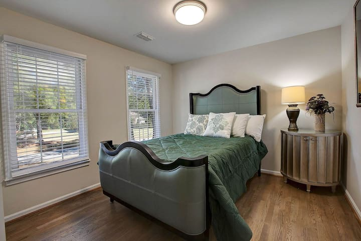 Bedroom one overlooks the side garden and features a large queen bed
