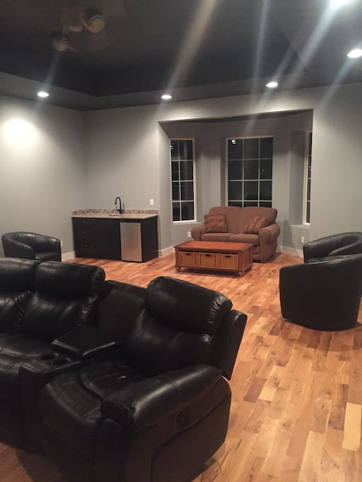 TV room with theater powered leather recliners