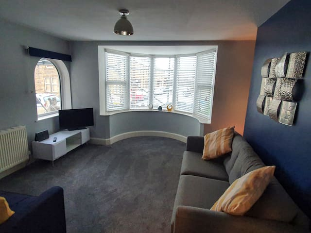 Spacious front room with sofa bed