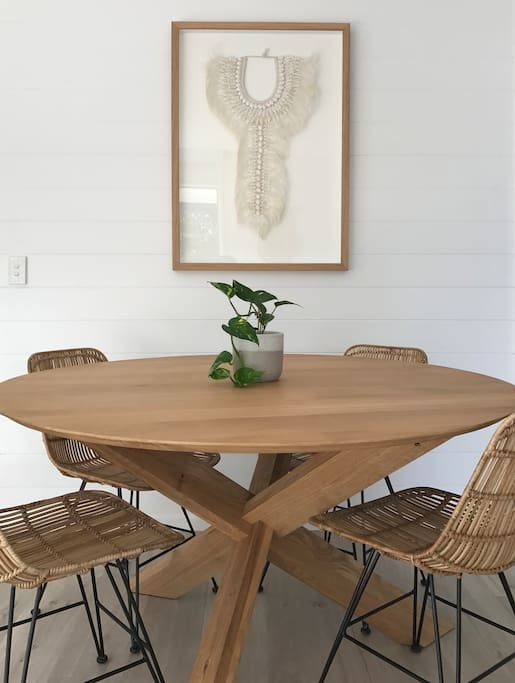 Round oak dining table with seating for four