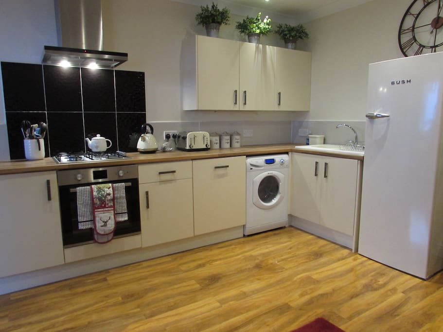 Fully fitted kitchen with gas hob, electric fan oven, extractor hood, fridge freezer, washer dryer and dishwasher - still leaving bags of cupboard space for anyone staying for longer periods