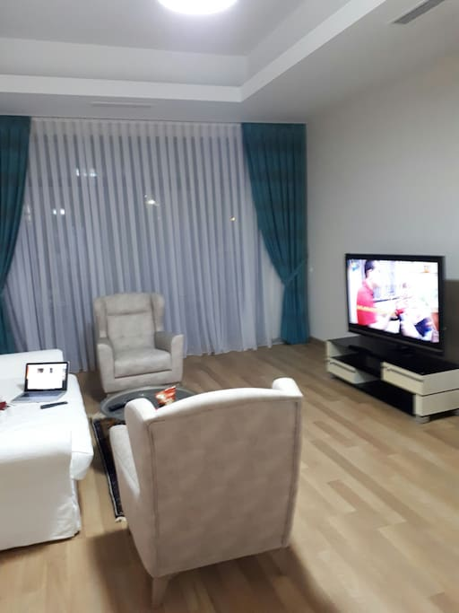 living room with 52 inch tv set