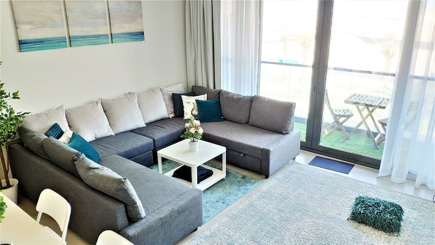 Sitting area with two queen-sized sofa beds.