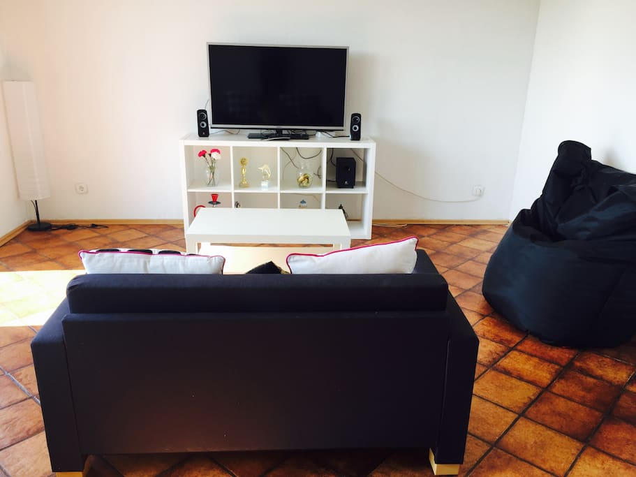 Living room with LCD television, lazy bag, sofa