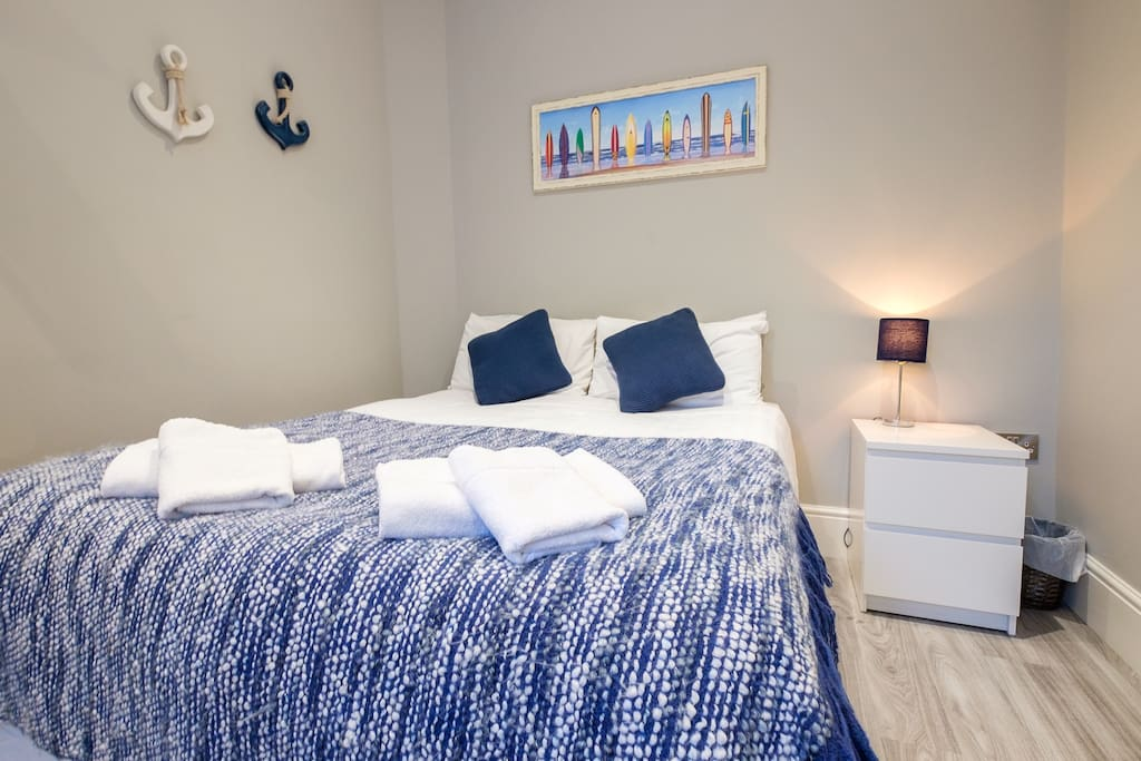 The double bedroom is made up with fresh linen and towels and has plenty of storage/hanging space