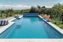 Heated pool shared with host few steps away from the cottage through the garden