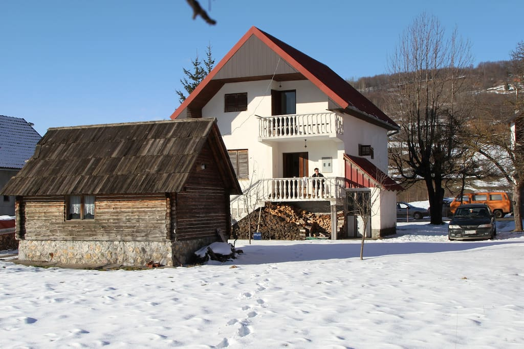 house, parking and a small ski-storage house