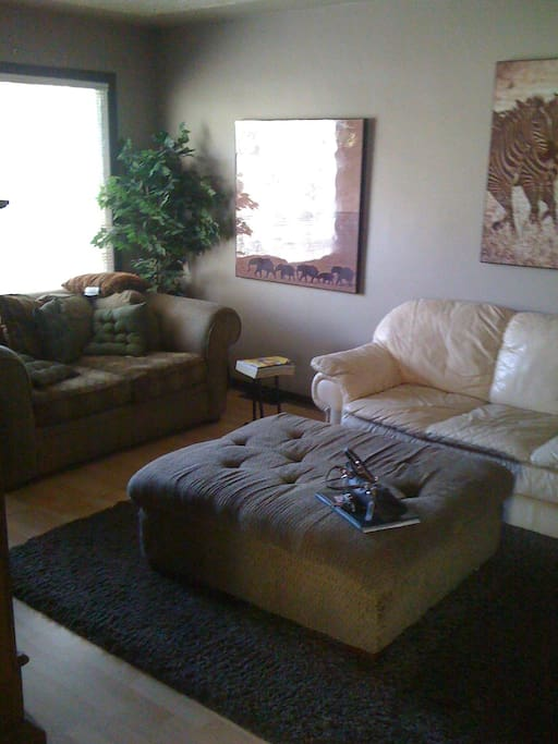 Living Room with Leather couch and soft sofa w/ ottoman