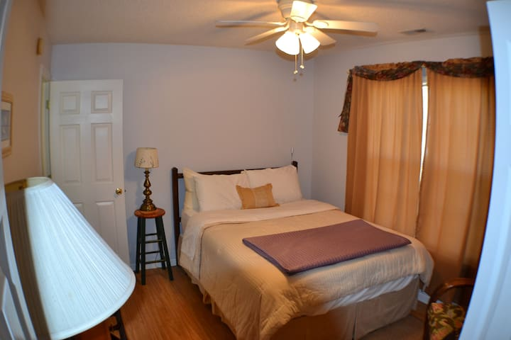 Second bedroom just as comfy as the master bedroom with a queen sized bed.