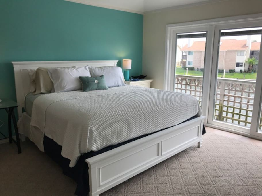 Upstairs Master Bedroom-King Bed with balcony overlooking the Canal