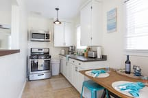 Full kitchen with all brand new appliances, cookware, tupperware and utensils.