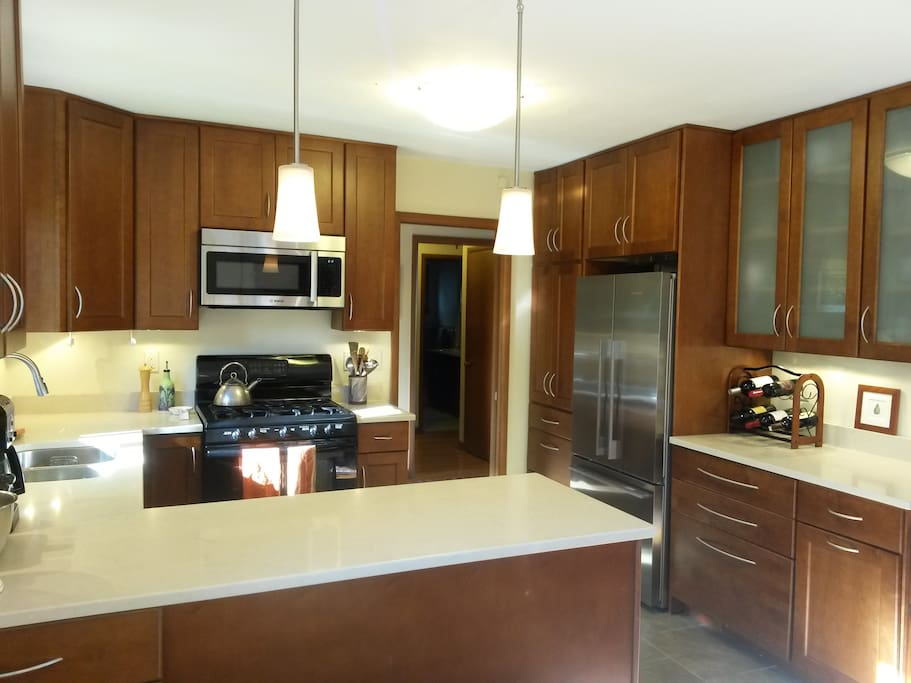 Updated kitchen with dishwasher, microwave, and all the amenities for those who enjoy cooking.