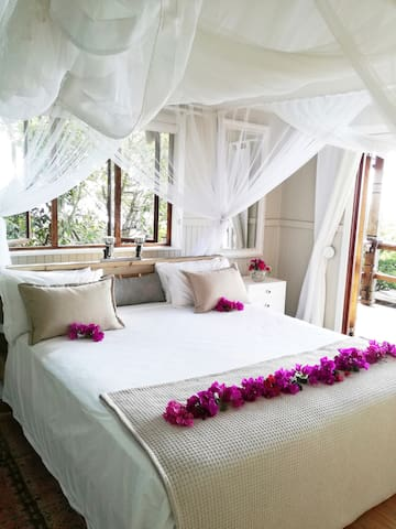 Upstairs spacious air conditioned main bedroom en-suit laid our for a honeymoon couple