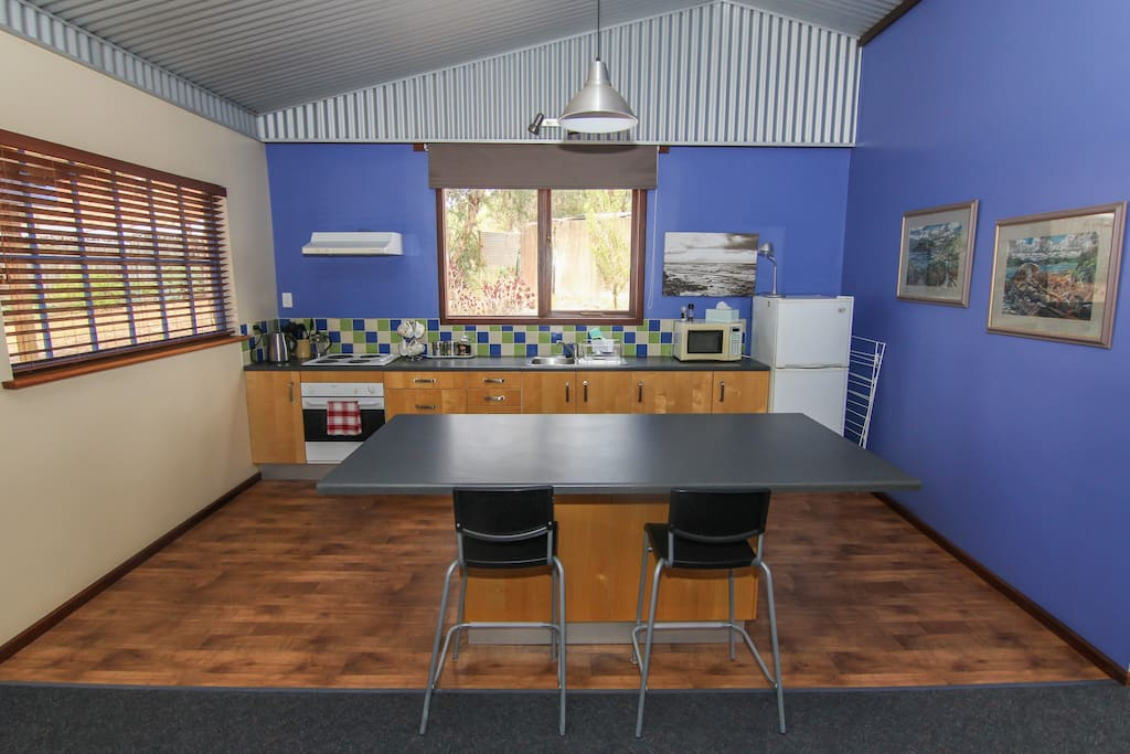The spacious well equipped kitchen is the perfect space to prepare a meal at the end of the day.  Or if you prefer you can BBQ on the back veranda.