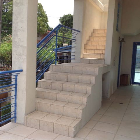 Stairway from open patio to rooftop deck