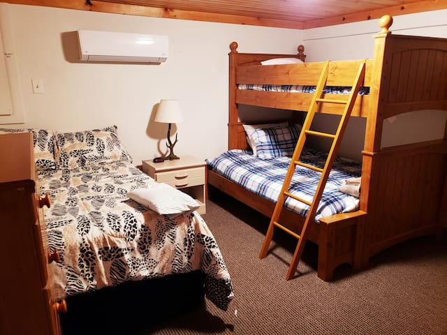 The 1st floor bedroom houses 2 full size beds as well as one 1 single.