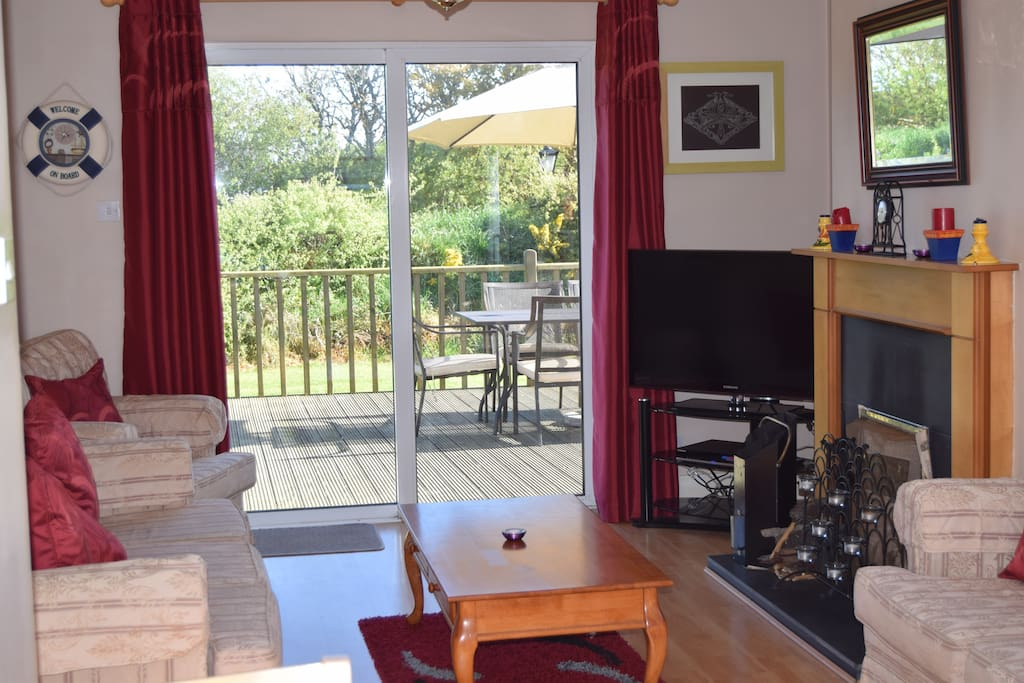 Lovely living area with patio doors leading to spacious deck area