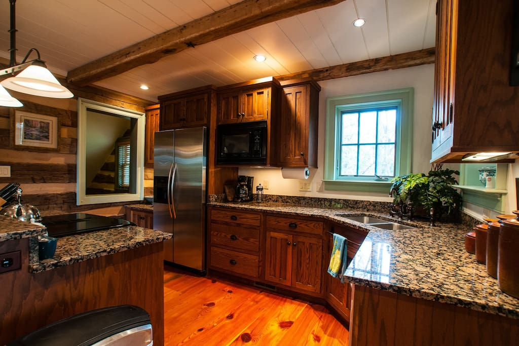 Kitchen, new granite, heart pine floors, wide boards-recycled