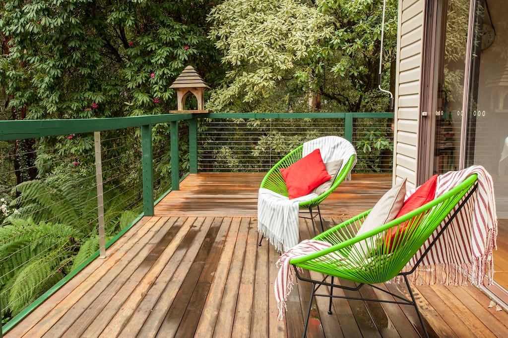 Sit in the sun on the deck and overlook the garden